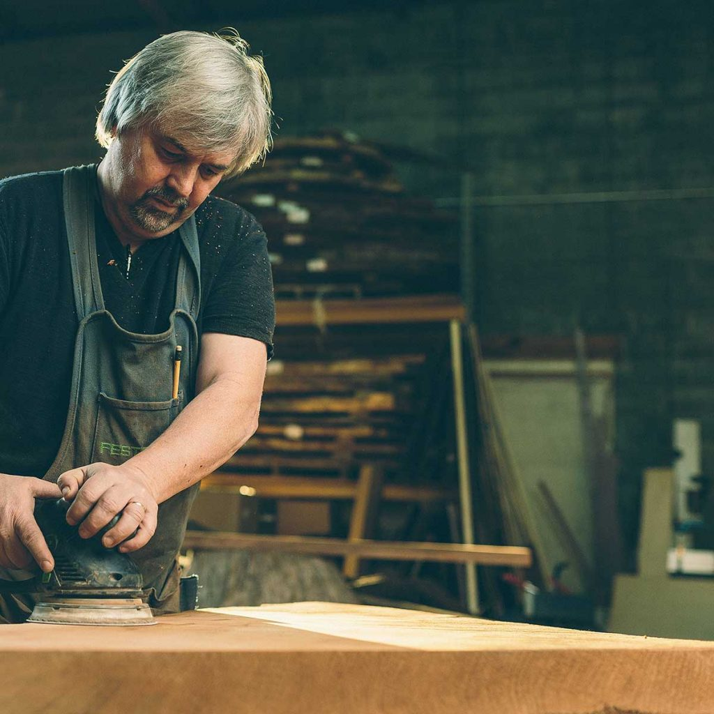 Kelly Maxwell building rustic furniture