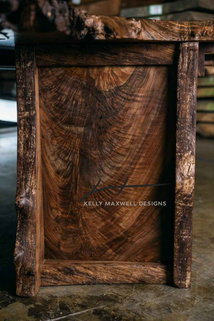 Live edge cabinet with walnut feather crotch panel.